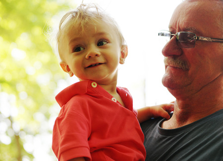 grand father: baby boy and his grand father happy Stock Photo