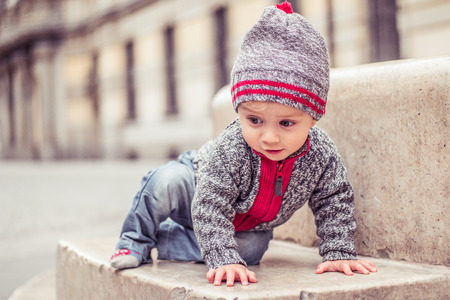 face of baby: happy little baby boy wearing hat in the city