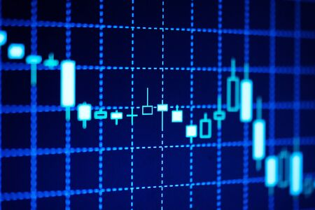 dynamic trend: Electronic candlestick chart used in financial analysis displayed on blue screen with grid showing a dynamic decreasing trend
