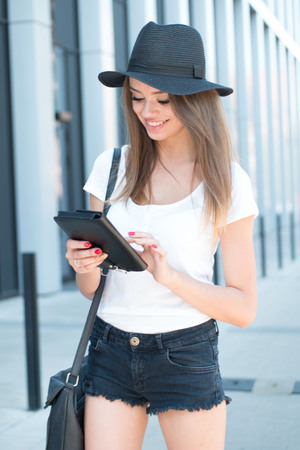 beautiful teen: Pretty Young Woman with Laptop Computer walking around the city Stock Photo