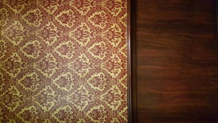 baroque wallpaper: dark interior room with baroque wallpaper and wood