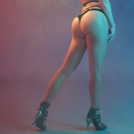 sexy woman buttocks and legs with high heels