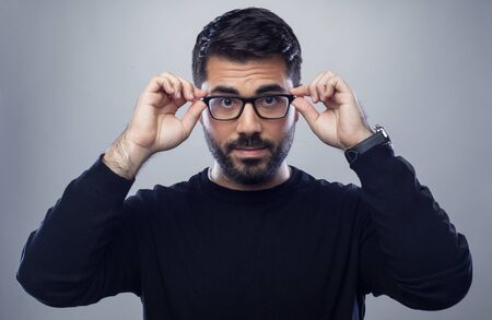 happy male business man holding his glasses