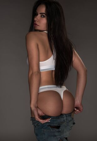 black ass: sexy fitness woman wearing white set and jeans ass after squats Stock Photo