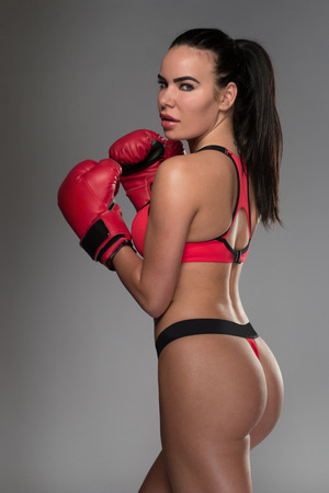 Young beautiful woman during fitness and boxing with big sexy ass