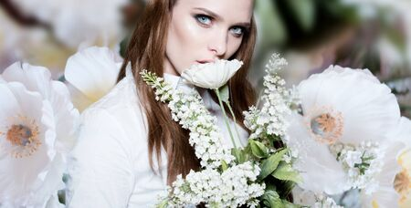 surrounded: Beautiful portrait of a young woman surrounded by the flowers
