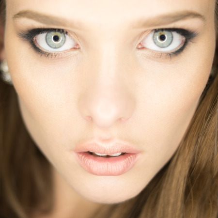 eyes hazel: magnificent portrait of a beautiful young woman with perfect skin and blue eyes Stock Photo
