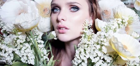 natural face: Beautiful portrait of a young woman surrounded by yellow flowers