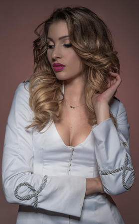 ombre: fashion female woman with curly hair and white suit with ombre hair