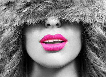 winter hat: pink lips and black and white portrait of woman wearing winter hat Stock Photo