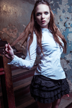 sexy teacher: Young beautiful girl wearing school outfit in the abandon place Stock Photo