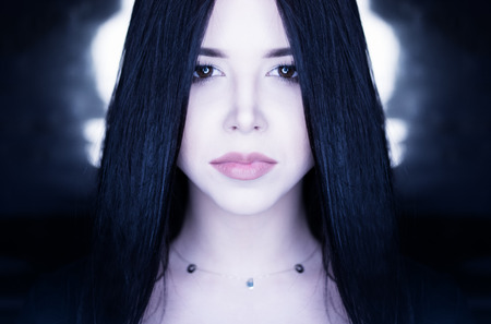 robot girl: conceptual portrait of a brunette girl with long straight hair