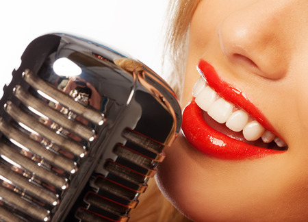 woman lips singing with retro microphone photo
