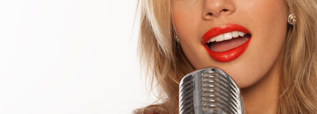 sexy singer lips with retro microphone on white photo