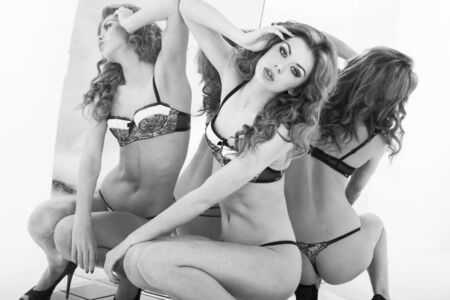 woman naked body: sexy girl in beautiful underwear in front of the mirror black and white