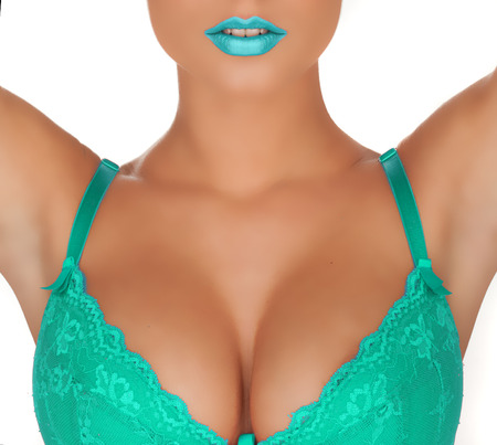 female with big breast and green bra and lips cleavage shoot on white Banco de Imagens