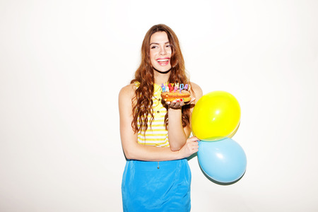 pretty birthday girl with ballons and cake