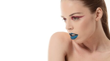 eye liner: High fashion look.glamor closeup beauty portrait of beautiful sensual Caucasian young woman model with  blue lips and red eye liner