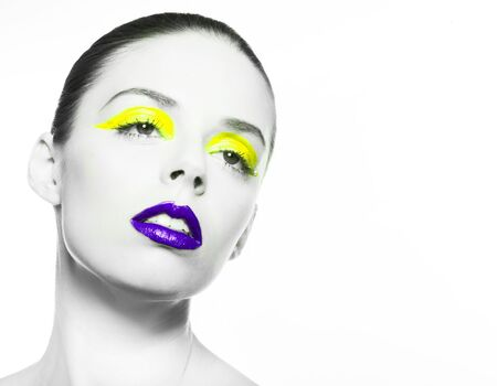eye liner: High fashion look.glamor closeup beauty portrait of beautiful sensual Caucasian young woman model with  purple lips and yellow eye liner Stock Photo