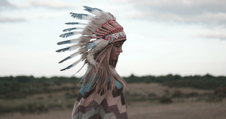 female shaman: Beautiful ethnic american indian lady with roach on her head.