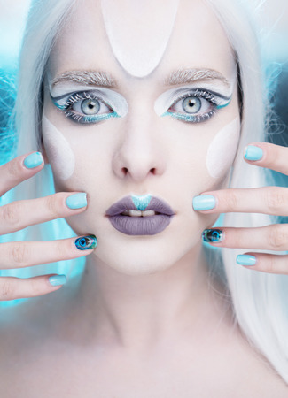 queen blue: pretty woman with snow queen frosted makeup and light blue gel nails