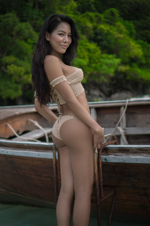 sexy asian woman: The girl in a bathing suit on a boat on Thai island of Phuket , Phiphi ,