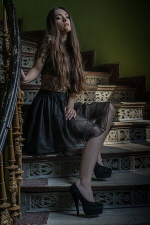 scarry: woman wearing dress in a horror scene stairs looking scarry