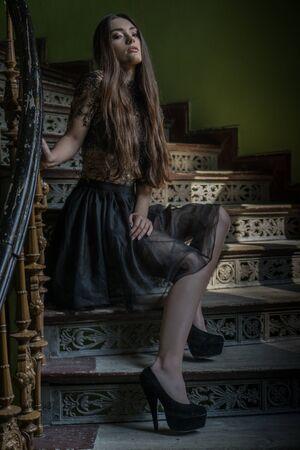 scarry: woman wearing dress in a horror scene stairs looking scarry