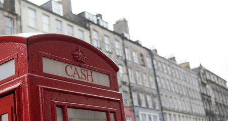 scotish: Top of the British Phone Booth with writing cash in Edinburgh, Scotland