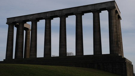 lothian: Bottom view of National Monument in Calton Hill over blue sky, Edinburgh, Scotland Stock Photo
