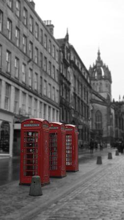 pay wall: Three British Phone Booths on Royal Mile street in Edinburgh, Scotland Editorial