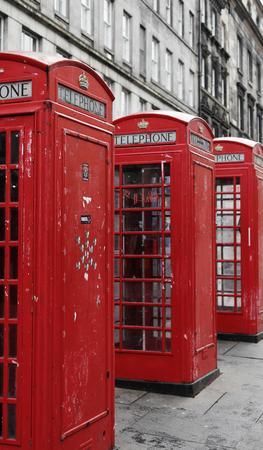 mile: Three British Phone Booths on Royal Mile street in Edinburgh, Scotland Editorial