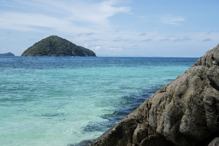 Beautiful view of crystal clear sea and rocks of tropical island, Koh He, Thailand Stock Photo