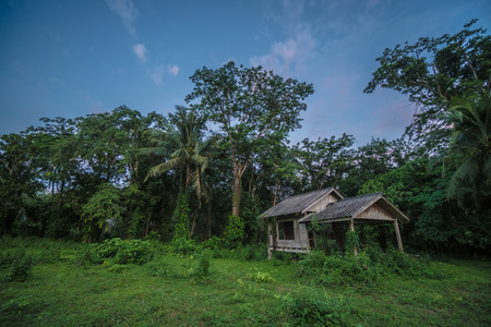 Scenics view of old wooden abandoned cottage against sky