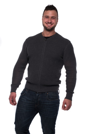 zipped: Happy relaxed young man in gray zipped sweater and denim jeans looking at camera isolated over white studio background