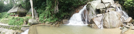 foe: Panaoramic view photo of small mountain waterfall on the rocks and cozy alcove foe relax in the tropical forest Stock Photo