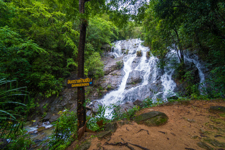 Photo of Dangerous sign over beautiful waterfall background