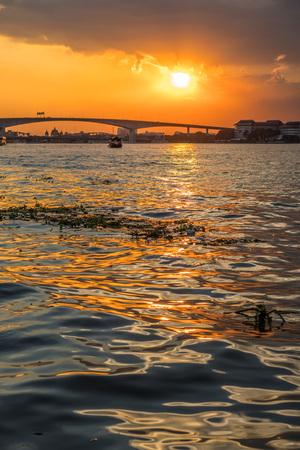 Boat view from Chao Praya river on Bangkok during beautiful sunset, Thailand
