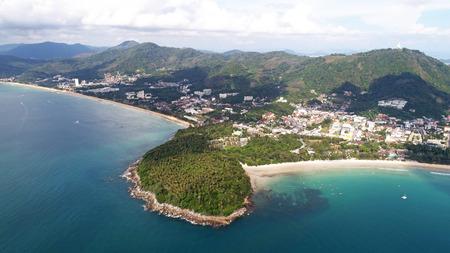 fullhd: Aerial view of small island, long tail boats on the sea near Kata beach in Phuket, Thailand Stock Photo