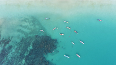 Aerial view of long tail boats on the sea near Kata beach in Phuket, Thailand Stock Photo
