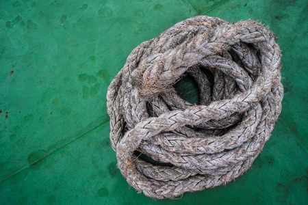 sailboard: Closeup photo of rope on green boats deck