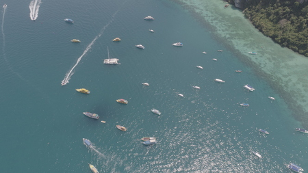 Aerial drone photo of sailing boats and yachts in the bay of iconic tropical Phi Phi island, Thailand