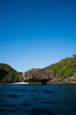 Limestone around Phi Phi island during sunny summer day, Thailand Stock Photo