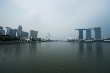 finacial: View of Art Science Museum, Marina Bay sands and Ferris Wheel in Singapore during cloudy day