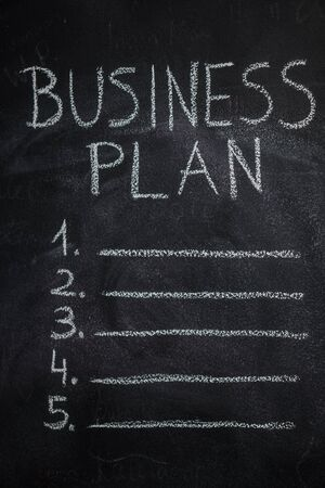 competitor: Business plan list written with white chalk on blackboard. To do list concept