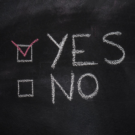 disagree: Yes or No written with chalk on blackboard Stock Photo