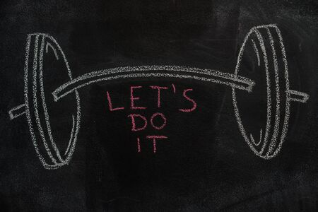 strenght: Barbell drawn and Lets do it text with white chalk on blackboard
