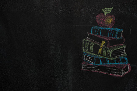 heap: Stack of books with apple drawn with chalk on blackboard. Education, school concept