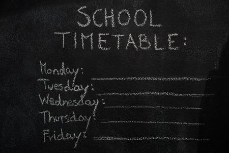 weekly: School timetable drawn with chalk on blackboard. Education, school concept