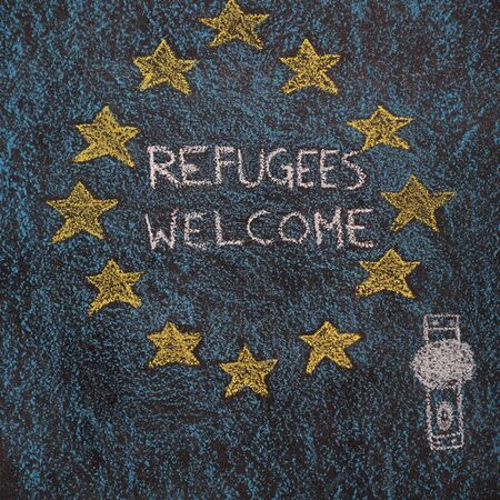 Flag of the European Union with door drawn with chalk on blackboard. Next to the door handle text Refugees Welcome